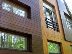 Отделка фасада деревянными панелями