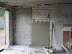 Штукатурим стену в гараже