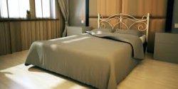 Плюсы кроватей из металла