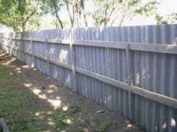 Как построить забор из волнистого шифера