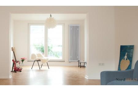 Вертикальный радиатор в интерьере дома